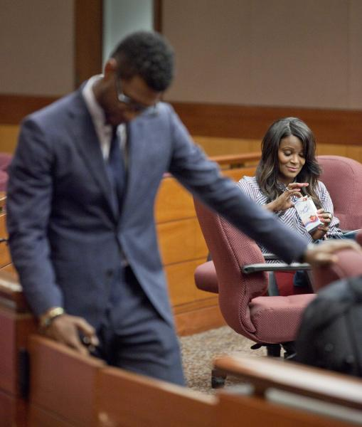 """Hip-hop artist Usher Raymond, left, stands in court during a brief recess in a legal battle with his ex-wife Tameka Foster Raymond, right, in a custody fight involving their two sons Tuesday, May 22, 2012, in Atlanta. The 33-year-old singer testified in court on Tuesday that Foster Raymond spit at and tried to fight his girlfriend during one nasty visit. He said his ex-wife hit him during the dispute, but that he didn't press charges because """"I didn't want the boys to know that their father put their mother in jail."""" The two were married in 2007 and divorced two years later. (AP Photo/David Goldman)"""