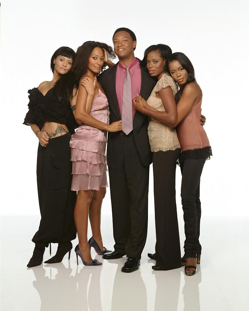 Reggie Hayes, who recently spoke out about his hard times, is seen here, at center, in a promotional cast photo for UPN television series 'Girlfriends,' in 2004. Also pictured, from left, are Persia White, Tracee Ellis Ross, Jill Marie Jones and Golden Brooks. (Photo: Darien Davis/CBS Photo Archive/Getty Images)