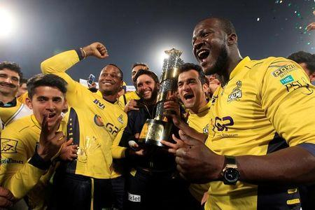 Cricket players of Peshawar Zalmi celebrate their victory over Quetta Gladiators in the final cricket match of the Pakistan Super League at Gaddafi Cricket Stadium in Lahore