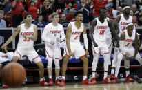 The New Mexico bench reacts after a basket during the second half of the team's NCAA college basketball game against Wyoming in the Mountain West Conference men's tournament Wednesday, March 13, 2019, in Las Vegas. (AP Photo/Isaac Brekken)