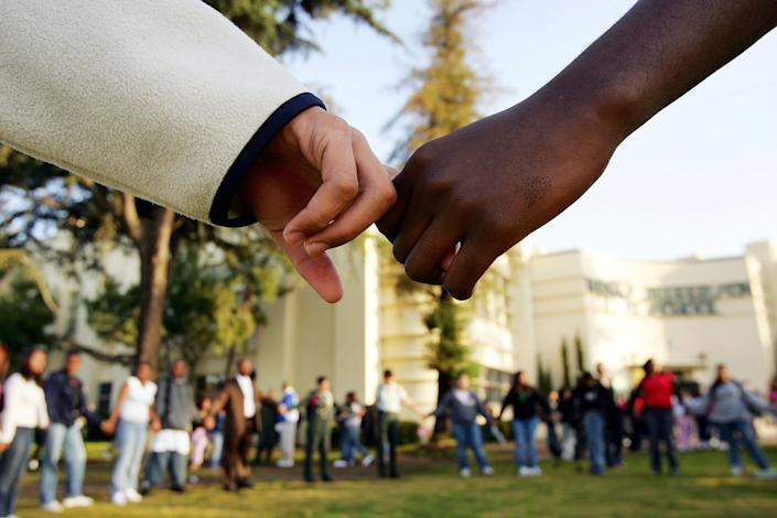 Students pray together at a high school in Los Angeles, California.  (Photo by David McNew / Getty Images)