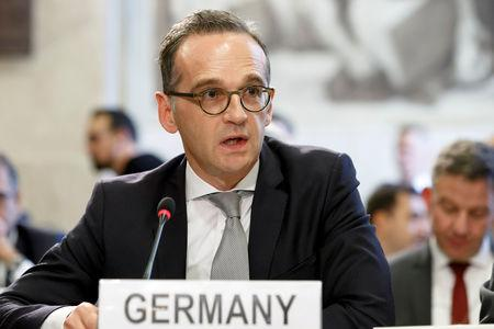 FILE PHOTO: German Minister of Foreign Affairs Heiko Maas delivers his statement, during the Geneva Conference on Afghanistan, at the European headquarters of the United Nations in Geneva, Switzerland, November 28, 2018.  Salvatore Di Nolfi/Pool via REUTERS/File Photo