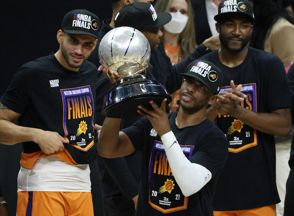 Chris Paul holds the Western Conference championship trophy after the Phoenix Suns defeated the Los Angeles Clippers in Game 6 of the Western Conference finals on June 30, 2021 in Los Angeles. (Harry How/Getty Images)