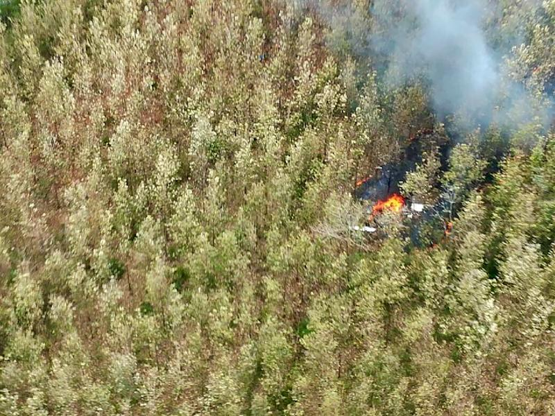This handout photo from Costa Rica's Public Security Ministry shows an aerial view of the still-burning crash site near Punta Islita, in the Costa Rican province of Guanacaste (AFP Photo/HO)