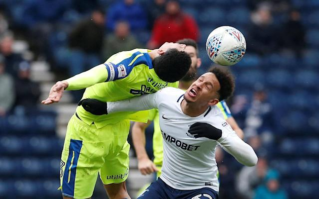 "Soccer Football - Championship - Preston North End vs Derby County - Deepdale, Preston, Britain - April 2, 2018 Derby County's Curtis Davies in action with Preston North End's Callum Robinson Action Images/Craig Brough EDITORIAL USE ONLY. No use with unauthorized audio, video, data, fixture lists, club/league logos or ""live"" services. Online in-match use limited to 75 images, no video emulation. No use in betting, games or single club/league/player publications. Please contact your account representative for further details."