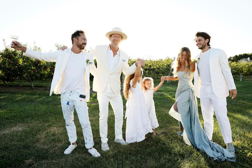 """""""Our chosen New York Family—Todd Cohen, Stella, Scarlett, Rebecca and Nicholas. Having an intimate wedding like this with family and a few close friends was so beyond special,"""" Dean says. """"We definitely made the most out of the cards we had been dealt."""""""