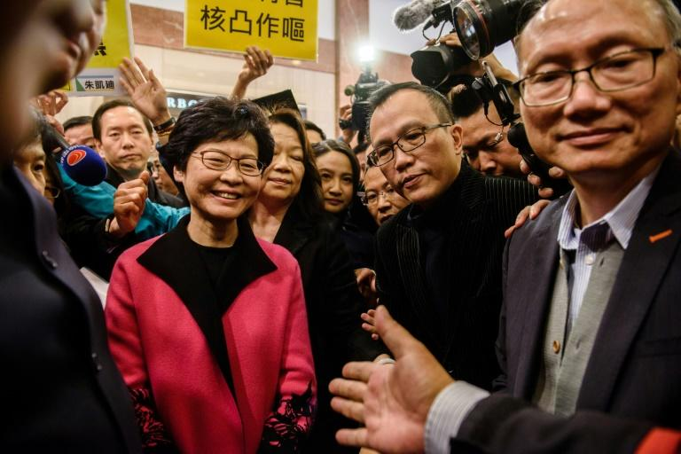Some pro-establishment lawmakers in Hong Kong have told how they have come under direct pressure to vote in favour of former deputy leader Carrie Lam (pictured, L)