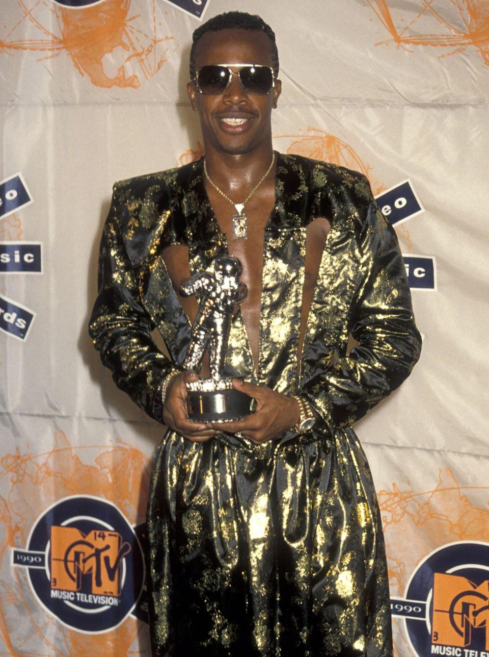 <p>MC Hammer's metallic pants were already famous by 1990, but his cutout blazer also caught attention at that year's VMAs.</p>