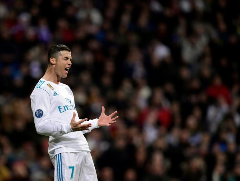 Real Madrid's Cristiano Ronaldo reacts to missing a goal during their match against Borussia Dortmund at the Santiago Bernabeu stadium in Madrid on December 6, 2017
