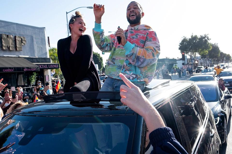 <p>John Legend and Chrissy Teigen celebrated President-elect Joe Biden's projected win with a parade of cars in West Hollywood.</p>