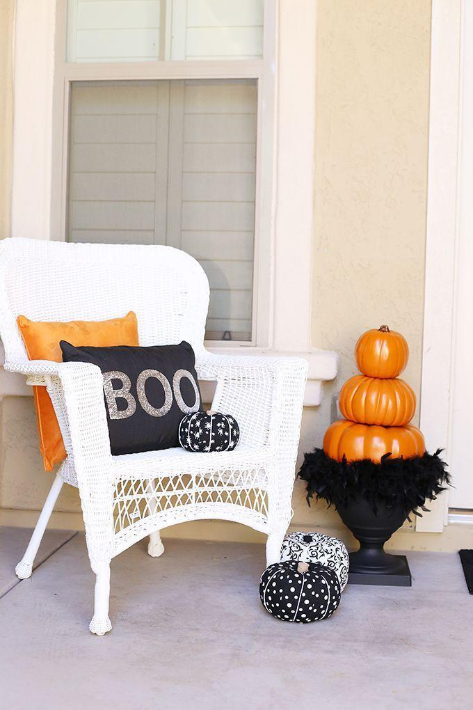 """<p>Add height to your front door display with this stacked topiary idea. It involves faux pumpkins, but nothing's stopping you from attempting it with a few real gourds too.</p><p><strong>Get the tutorial at <a href=""""https://seevanessacraft.com/2017/09/halloween-stacked-pumpkin-topiary/"""" rel=""""nofollow noopener"""" target=""""_blank"""" data-ylk=""""slk:See Vanessa Craft"""" class=""""link rapid-noclick-resp"""">See Vanessa Craft</a>.</strong></p><p><strong><a class=""""link rapid-noclick-resp"""" href=""""https://go.redirectingat.com?id=74968X1596630&url=https%3A%2F%2Fwww.walmart.com%2Fip%2FHalloween-Artificial-Pumpkin-Simulation-Fake-Lifelike-Props-Garden-Home-Decor%2F371789666&sref=https%3A%2F%2Fwww.thepioneerwoman.com%2Fholidays-celebrations%2Fg32894423%2Foutdoor-halloween-decorations%2F"""" rel=""""nofollow noopener"""" target=""""_blank"""" data-ylk=""""slk:SHOP FAUX PUMPKINS"""">SHOP FAUX PUMPKINS</a><br></strong></p>"""