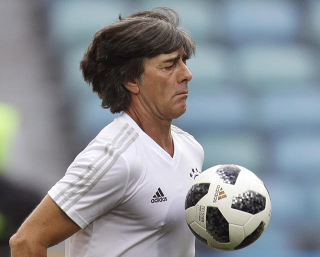 Germany head coach Joachim Loew juggles with the ball during a training session of the German national soccer team on the eve of their Group F match against Sweden, during the 2018 soccer World Cup in Sochi, Russia, Friday, June 22, 2018. (AP Photo/Michael Probst)