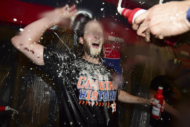Houston Astros starting pitcher Gerrit Cole celebrates with teammates after the Astros defeated the Cleveland Indians 11-3 in Game 3 of a baseball American League Division Series, Monday, Oct. 8, 2018, in Cleveland. (AP Photo/David Dermer)