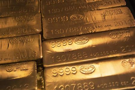 24 karat gold bars are seen at the United States West Point Mint facility in West Point, New York
