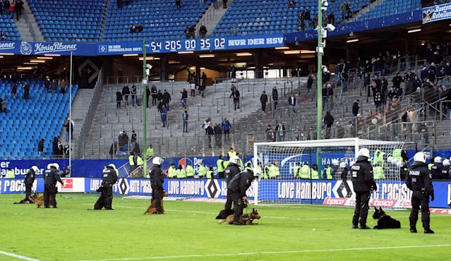Soccer Football - Bundesliga - Hamburger SV vs Hertha BSC - Volksparkstadion, Hamburg, Germany - March 17, 2018 Police dog handlers on the pitch after the match REUTERS/Fabian Bimmer DFL RULES TO LIMIT THE ONLINE USAGE DURING MATCH TIME TO 15 PICTURES PER GAME. IMAGE SEQUENCES TO SIMULATE VIDEO IS NOT ALLOWED AT ANY TIME. FOR FURTHER QUERIES PLEASE CONTACT DFL DIRECTLY AT + 49 69 650050