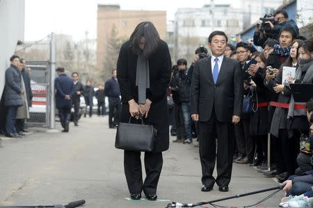Cho Hyun-ah, also known as Heather Cho, daughter of chairman of Korean Air Lines, Cho Yang-ho, bows in front of the media outside the offices of the Aviation and Railway Accident Investigation Board of the Ministry of Land, Infrastructure, Transport, in Seoul December 12, 2014. REUTERS/Song Eun-seok/News1