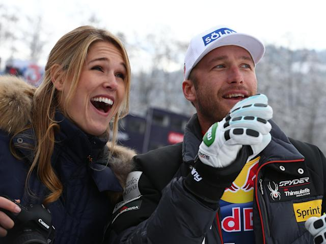 Bode Miller, of the United States, and his wife Morgan smile at the finish area at the end of an alpine ski, men's World Cup downhill, in Kitzbuehel, Austria, Saturday, Jan. 25, 2014. (AP Photo/Giovanni Auletta)