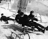 <p>The Beatles – Paul McCartney (front), John Lennon (middle), George Harrison (back), and Ringo Starr (fallen off the back) – partake in a little snow sledding, Austria, 1965.</p>