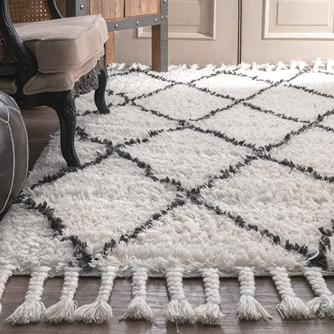 """<h3><a href=""""https://amzn.to/3865vb8"""" rel=""""nofollow noopener"""" target=""""_blank"""" data-ylk=""""slk:nuLoom Venice Morracon Rug"""" class=""""link rapid-noclick-resp"""">nuLoom Venice Morracon Rug</a></h3><br>Instead of stepping onto your cold floors first thing in the morning, add a soft, plush rug to your bedside for a much more pleasant experience.<br><br><br><br><strong>nuLOOM</strong> Venice Moroccan Shag Rug, $, available at <a href=""""https://amzn.to/3kSjPYr"""" rel=""""nofollow noopener"""" target=""""_blank"""" data-ylk=""""slk:Amazon"""" class=""""link rapid-noclick-resp"""">Amazon</a>"""