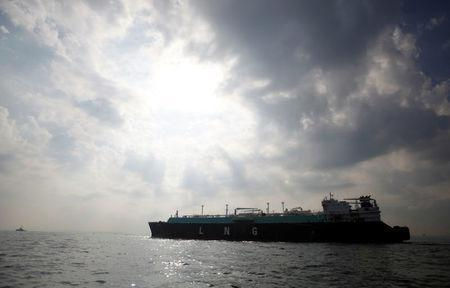 FILE PHOTO - A liquefied natural gas (LNG) carrying vessel sails at Tokyo Bay, offshore of Yokosuka, south of Tokyo, Japan October 22, 2012. REUTERS/Issei Kato/File Photo