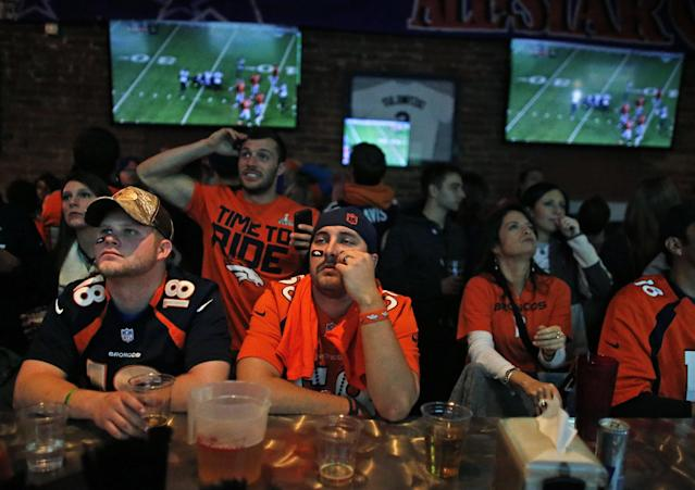 Denver Broncos fans watch their team get outplayed by the Seahawks during the first half of the Super Bowl, inside Jackson's, a sports bar and grill in Denver, Sunday, Feb. 2, 2014. (AP Photo/Brennan Linsley)