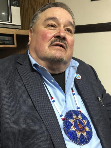 """Standing Rock Sioux Tribal Chairman Mike Faith poses for a photo Wednesday, Nov. 13, 2019 in Linton, North Dakota. Faith says doubling the capacity of the Dakota Access pipeline increases the """"consequences as well as the likelihood"""" of an oil spill. (AP Photo/James MacPherson)."""