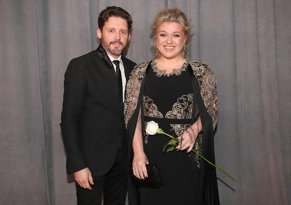 """<p>The <em>Voice</em> judge and <em>American Idol</em> winner met her husband since 2013 through her manager, who is Blackstock's father.</p><p>She'd known him for several years before they got together. It wasn't until Clarkson's performance at the 2012 Super Bowl when she found out he was no longer married that things became romantic. </p><p>""""Brandon is my manager's son. I've known him for six years, but he was married for most of that time,"""" she said to the <a href=""""https://www.dailymail.co.uk/home/you/article-2148795/Kelly-Clarkson-The-superstar-door.html"""" rel=""""nofollow noopener"""" target=""""_blank"""" data-ylk=""""slk:Daily Mail"""" class=""""link rapid-noclick-resp""""><em>Daily Mail</em></a><em>.</em> """"Then, suddenly, there he was at the Super Bowl, and he was single.""""</p>"""