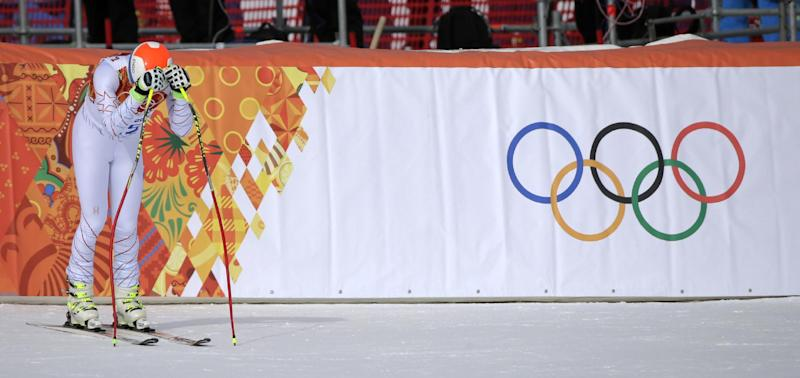 United States' Bode Miller rests on his ski poles after finishing the men's downhill at the Sochi 2014 Winter Olympics, Sunday, Feb. 9, 2014, in Krasnaya Polyana, Russia. (AP Photo/Gero Breloer)