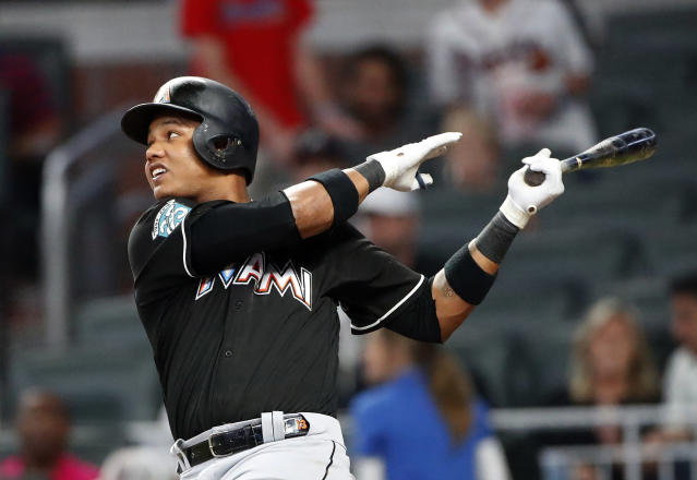 Miami Marlins' Starlin Castro (13) drives in a run with a double in the sixth inning of a baseball game against the Atlanta Braves, Friday, May 18, 2018, in Atlanta. (AP Photo/John Bazemore)