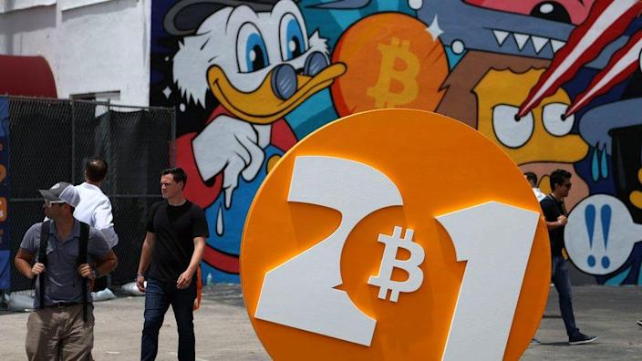 People enjoy themselves at the Bitcoin 2021 Convention, a crypto-currency conference in Miami