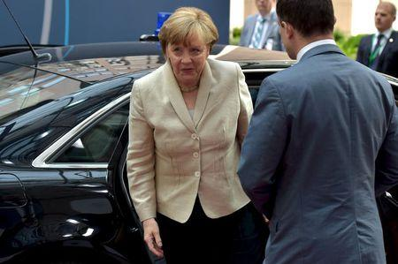 Germany's Chancellor Angela Merkel arrives at the EU Council headquarters at the start of a European Union leaders summit in Brussels, Belgium, June 26, 2015. REUTERS/Eric Vidal