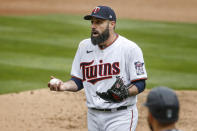 Minnesota Twins' Matt Shoemaker reacts to home plate umpire Adam Hamari after getting ejected from a baseball game with the Seattle Mariners in the sixth inning Sunday, April 11, 2021, in Minneapolis. (AP Photo/Bruce Kluckhohn)