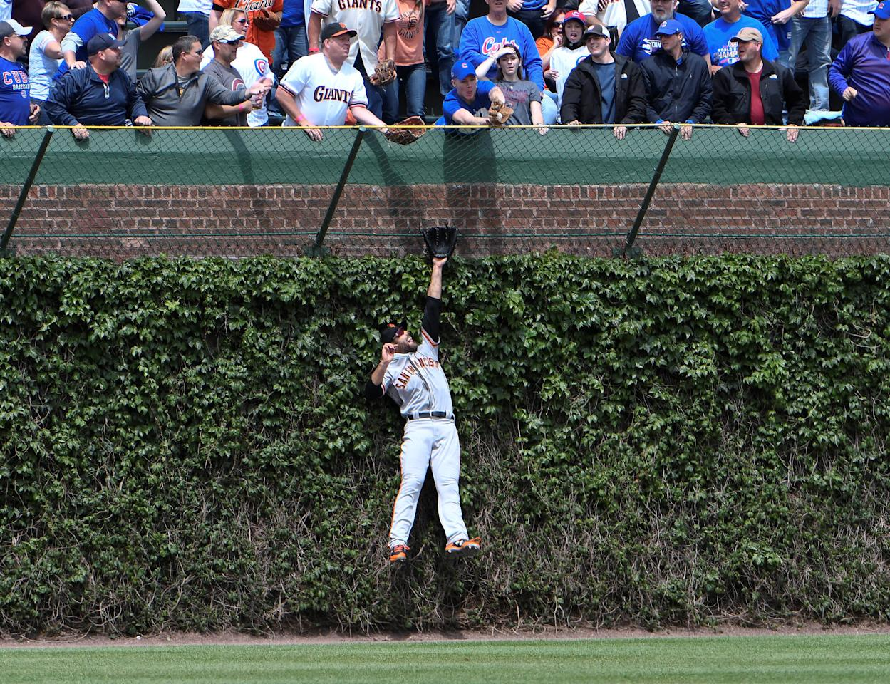 May 25, 2017; Chicago, IL, USA; San Francisco Giants left fielder Mac Williamson (51) cannot catch a home run hit by Chicago Cubs third baseman Kris Bryant (not pictured) during the first inning at Wrigley Field. Mandatory Credit: David Banks-USA TODAY Sports     TPX IMAGES OF THE DAY