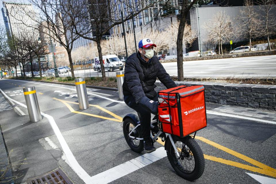 A delivery worker riding a bike.