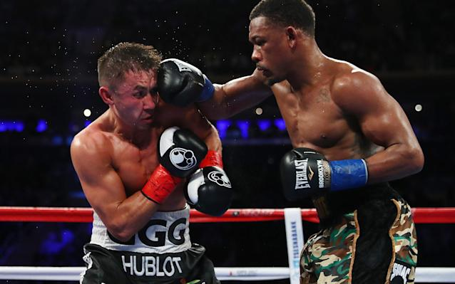 Daniel Jacobs punches Gennady Golovkin during their bout in New York - 2017 Getty Images
