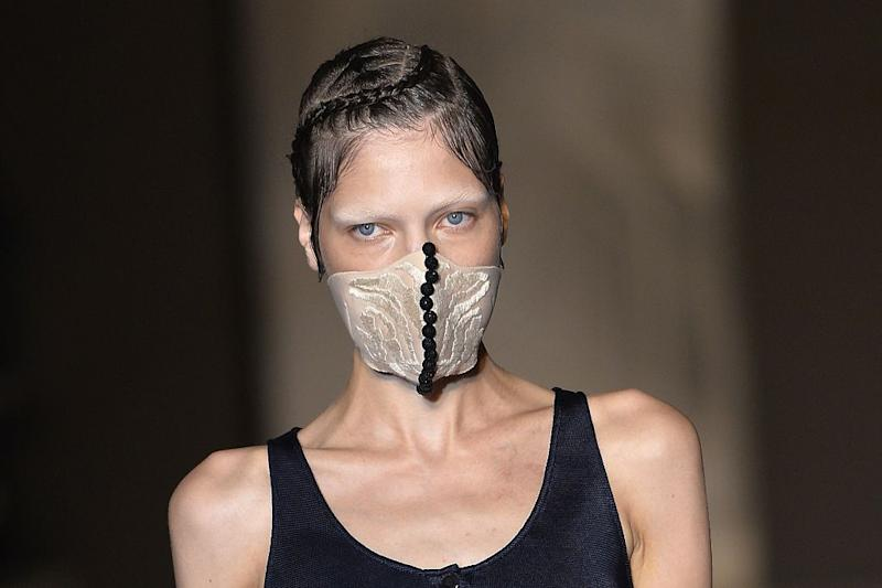 Face masks have been making an appearance on the catwalk [Photo: Getty]