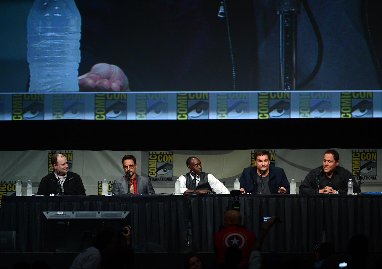 """SAN DIEGO, CA - JULY 14:  (L-R) Producer Kevin Feige, actors Robert Downey Jr., Don Cheadle, director Shane Black, and actor Jon Favreau speak at Marvel Studios """"Iron Man 3"""" panel during Comic-Con International 2012 at San Diego Convention Center on July 14, 2012 in San Diego, California.  (Photo by Kevin Winter/Getty Images)"""