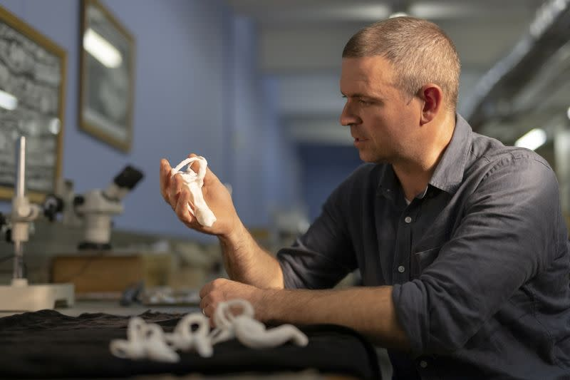 Professor Jonah Choiniere of the University of the Witwatersrand is seen holding a 3D printed model of the lagena