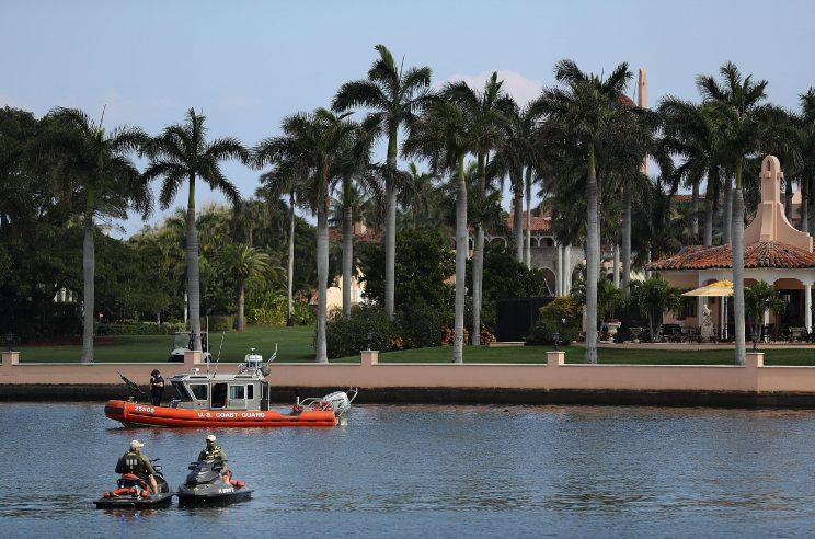 Coast Guard and law enforcement personnel patrol in front of the Mar-a-Lago resort. (Photo: Joe Raedle/Getty Images)