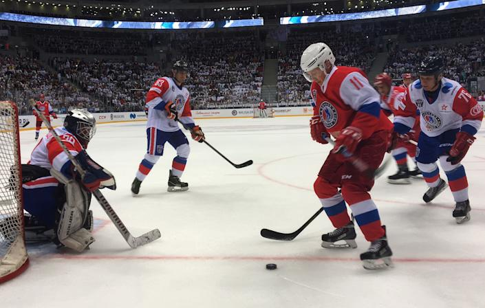Vladimir Putin, Russia's president, right, plays a gala ice hockey match in the night hockey league in Sochi, Russia, on Wednesday, May 10, 2017.