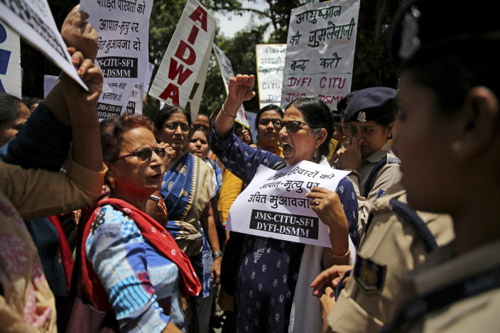Left wing activists shout slogans as they protest against deaths of more than 100 children due to Encephalitis in the Indian state of Bihar, in New Delhi, India, Tuesday, June 18, 2019. (AP Photo/Altaf Qadri)