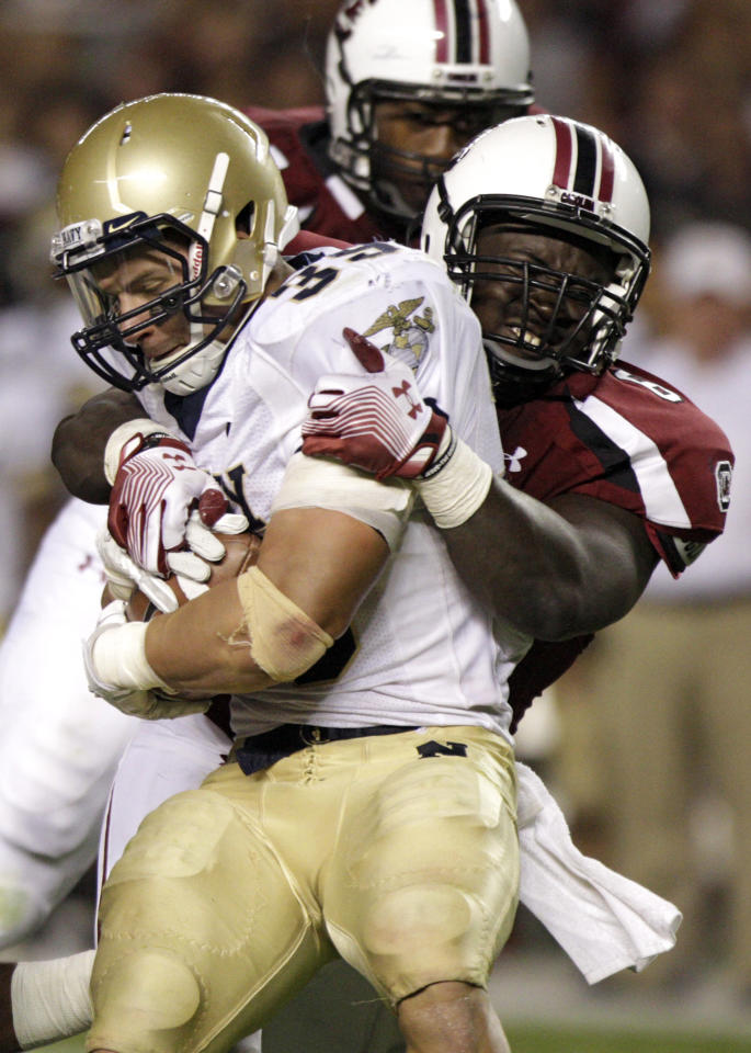 FOR USE AS DESIRED WITH NFL DRAFT STORIES - FILE - In this Sept. 17, 2011, file photo, Navy fullback Alexander Teich, left, is tackled by South Carolina defensive end Melvin Ingram, right, during the second half of an NCAA college football game at Williams-Brice Stadium, in Columbia, S.C. Ingram is a top prospect in the upcoming NFL football draft. (AP Photo/Brett Flashnick, File)