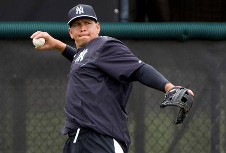 New York Yankees third baseman Alex Rodriguez (13) throws during afternoon  workouts at New York Yankee Minor League Complex. Mandatory Credit: Tommy Gilligan-USA TODAY Sports