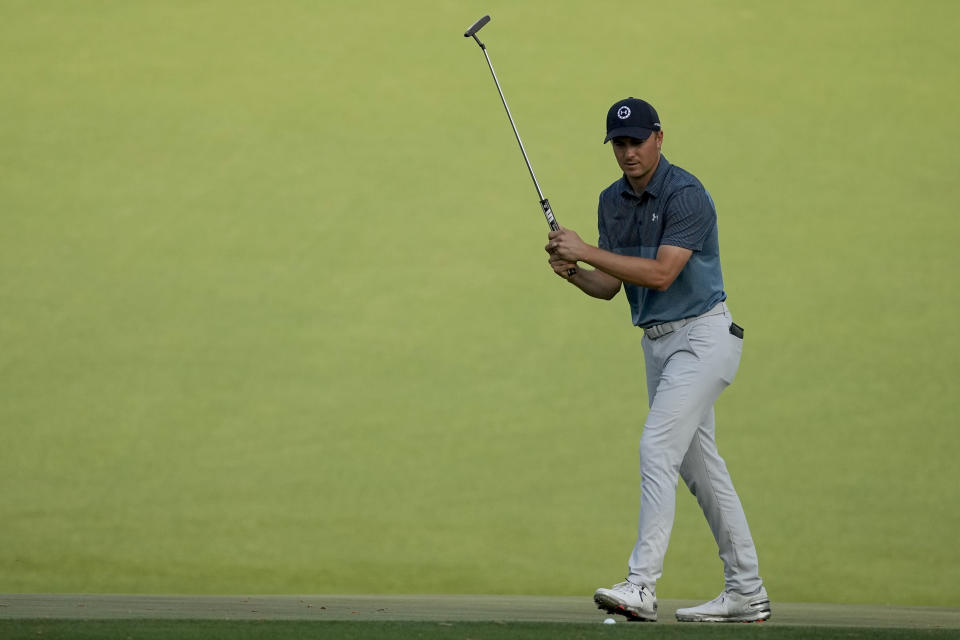 Jordan Spieth reacts to a missed birdie putt on the 15th green during the final round of the Masters golf tournament on Sunday, April 11, 2021, in Augusta, Ga. (AP Photo/Charlie Riedel)