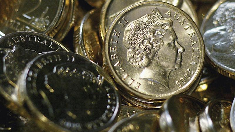 The photo shows a close up shot of several $2 coins.