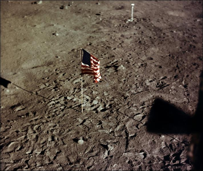 A NASA photo taken on July 20, 1969 shows the US flag and the footprints of astronauts Neil A. Armstrong and Edwin E. Aldrin on the surface of the moon (AFP Photo/Handout)