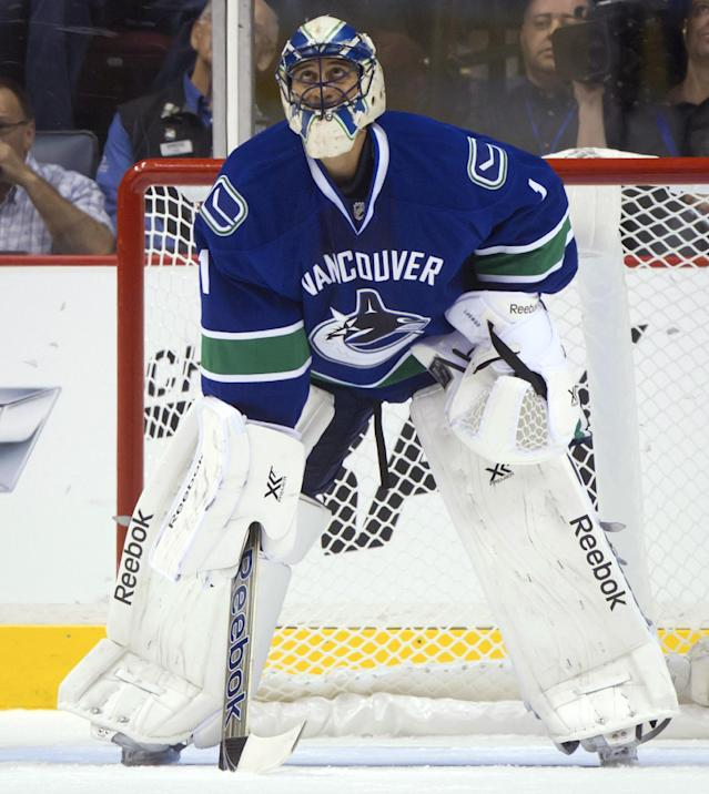 Vancouver Canucks goalie Roberto Luongo watches the replay after allowing a goal to the Edmonton Oilers during the first period of a preseason NHL hockey game Wednesday, Sept. 18, 2013, in Vancouver, British Columbia. (AP Photo/The Canadian Press, Darryl Dyck)