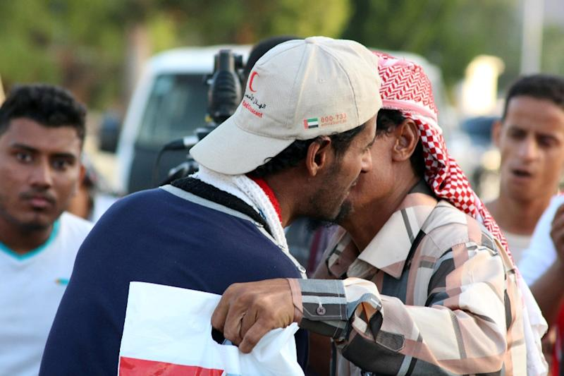 A Yemeni pro-government fighter is welcomed back by relatives and friends in Lahj governorate (AFP Photo/Saleh al-Obeidi)