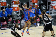 Oklahoma City Thunder forward Aleksej Pokusevski (17) passes the ball against Los Angeles Clippers forward Patrick Patterson (54) and center Ivica Zubac (40) during the second quarter of an NBA basketball game Sunday, Jan. 24, 2021, in Los Angeles. (AP Photo/Ashley Landis)