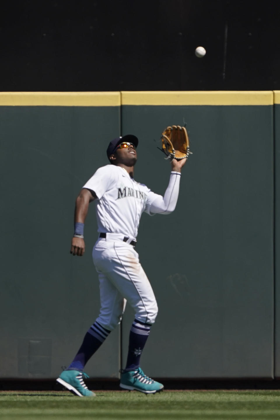 Seattle Mariners center fielder Kyle Lewis catches a fly ball from Los Angeles Dodgers' Will Smith in the fourth inning of a baseball game Tuesday, April 20, 2021, in Seattle. (AP Photo/Ted S. Warren)